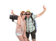 Young attractive and chic American couple taking selfie photo with mobile phone isolated on white Royalty Free Stock Images