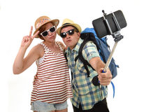 Young attractive and chic American couple taking selfie photo with mobile phone isolated on white Stock Photo