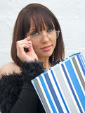 Young attractive college Lecturer. An image of a female College lecturer peering over her spectacles and carrying a blue striped folder with her lecture notes Stock Images