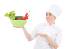 Young attractive cook woman in uniform with vegetables isolated Stock Photo