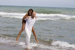 Young attractive couple on the beach Stock Photos