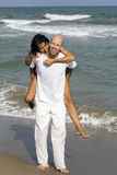 Young attractive couple on the beach Royalty Free Stock Photography