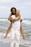 Young attractive couple on the beach Stock Photo