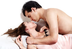 Young attractive  couple in bedroom Stock Photos