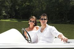Young attractive couple on boat Stock Photo