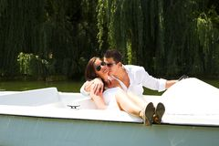 Young attractive couple on boat Royalty Free Stock Image
