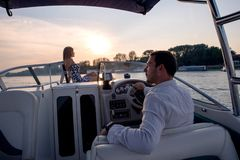 Boat ride, man is driving boat stock photography