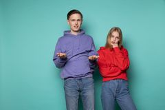 Young attractive couple in casual clothes standing daspleased after quarrel stock photography