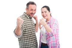 Young attractive couple cheering together Stock Images