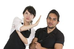 Young attractive couple chefs wearing black apron Stock Image