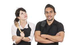 Young attractive couple chefs wearing black apron Stock Photography