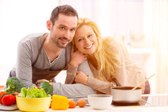 Young attractive couple cooking in a kitchen Royalty Free Stock Photography