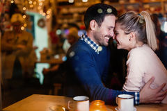 Young attractive couple on date in bar Royalty Free Stock Photography
