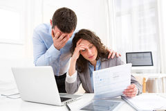 Young attractive couple doing paperwork Royalty Free Stock Image