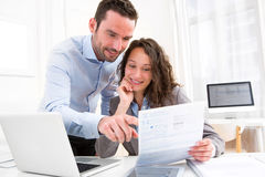 Young attractive couple doing paperwork Stock Images