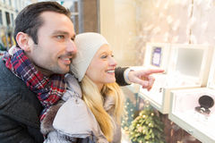 Young attractive couple doing some window shopping Stock Photography