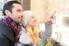 Young attractive couple doing some window shopping Stock Photo