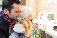 Young attractive couple doing some window shopping Royalty Free Stock Photography