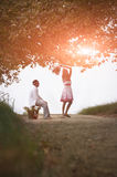 Young attractive couple flirting together on dirt road Stock Images