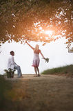 Young attractive couple flirting together on dirt road Stock Photography