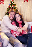 Young attractive couple  in front of christmas tree Royalty Free Stock Photos