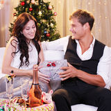 Young attractive couple  in front of christmas tree Stock Image