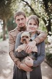 Young attractive couple going for a walk with their dog Stock Photo