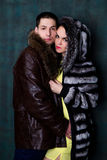 Young attractive couple. Handsome man and sexy woman in fur coat Royalty Free Stock Photography