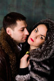 Young attractive couple. Handsome man and sexy woman in fur coat Royalty Free Stock Images