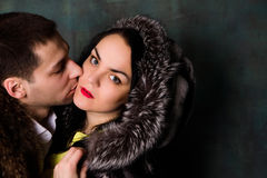 Young attractive couple. Handsome man and sexy woman in fur coat Stock Photo