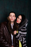 Young attractive couple. Handsome man and sexy woman in fur coat Stock Photography