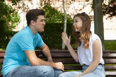 Young attractive couple have an argument over something, outdoor shoot royalty free stock image