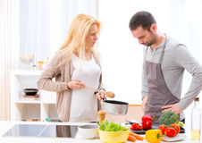 Young attractive couple having an argue while cooking Stock Photography