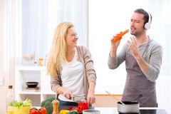 Young attractive couple having fun in the kitchen Royalty Free Stock Photos