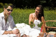 Young attractive couple having a picknick Royalty Free Stock Photo