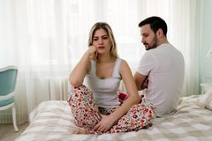 Young couple having problems in their relationship. Young attractive couple having problems in their relationship Stock Images