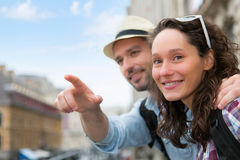 Young attractive couple on holidays in city Royalty Free Stock Images