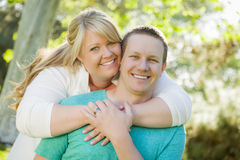 Young Attractive Couple Hugging in the Park Stock Photography