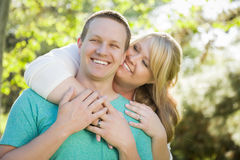 Young Attractive Couple Hugging in the Park Royalty Free Stock Photography