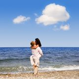 Young attractive couple kisses Stock Photography