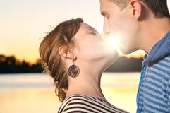 Young attractive couple is kissing Royalty Free Stock Photography