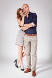 Young attractive couple in love embracing portrait. On grey backgound Royalty Free Stock Photo