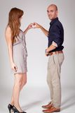 Young attractive couple in love embracing portrait. On grey backgound Royalty Free Stock Photos