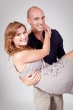 Young attractive couple in love embracing portrait. On grey backgound Stock Image