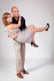 Young attractive couple in love embracing portrait. On grey backgound Royalty Free Stock Images