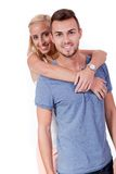 Young attractive couple in love embracing portrait. On grey backgound Stock Photography