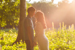 Young attractive couple in love kissing in summer nature Stock Photo
