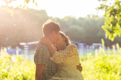 Young attractive couple in love kissing in summer nature. Young attractive couple in love kissing in summer in field Royalty Free Stock Photos