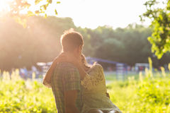 Young attractive couple in love kissing in summer nature. Young attractive couple in love kissing in summer in field Stock Image