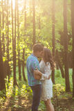 Young attractive couple in love kissing in summer nature. Young attractive couple in love kissing in summer in field Royalty Free Stock Photo